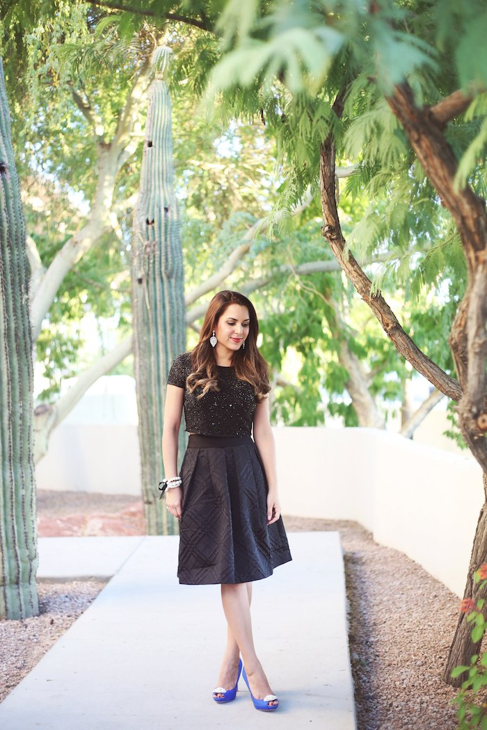Black bow skirt + sequin crop top, cute holiday outfit idea. Click to see the rest of the look on the blog!