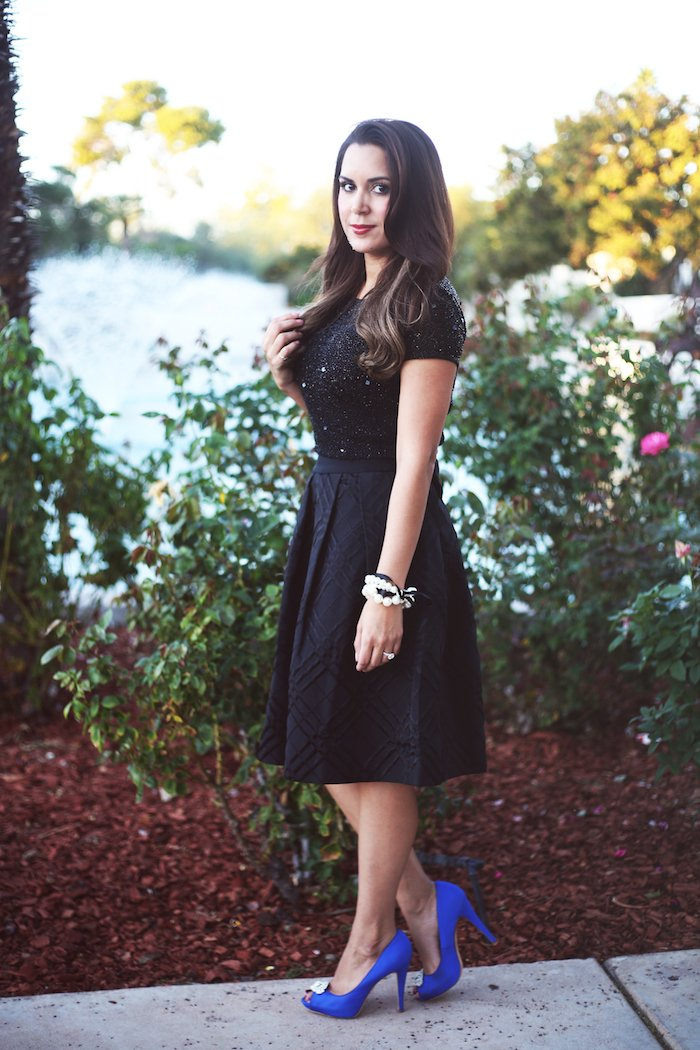 Ted Baker black bow skirt + sequin crop top, cute holiday outfit idea. Click to see the rest of the look on the blog!