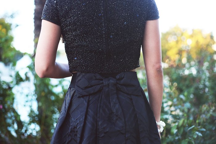 Love this Ted Baker black bow skirt! Looks great with a sequin crop top, perfect holiday outfit idea. Click to see the rest of this look!