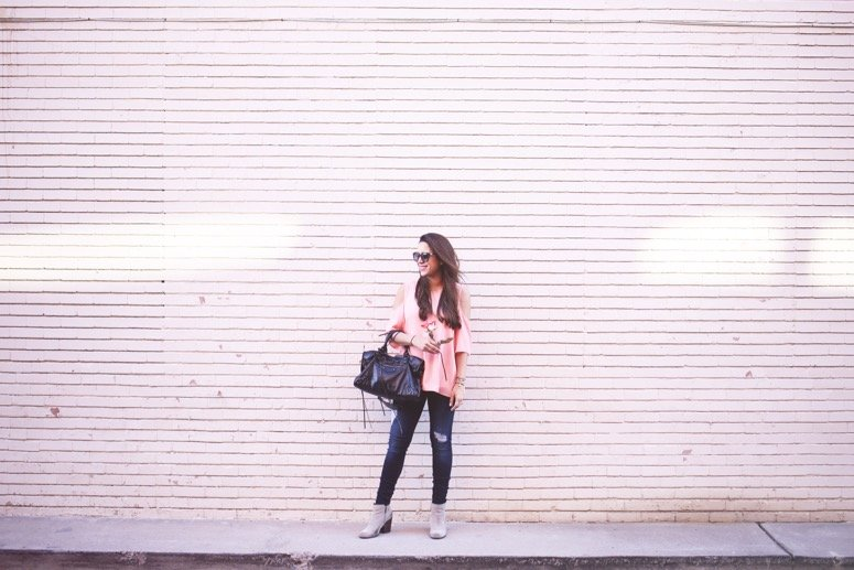 casual valentine's day outfit idea pink cold shoulder top and distressed jeans. Click to see where to get this look!