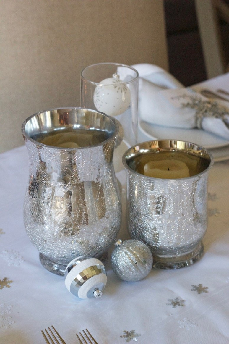 white and silver holiday tablescape idea. Click to see the rest of this holiday party decor