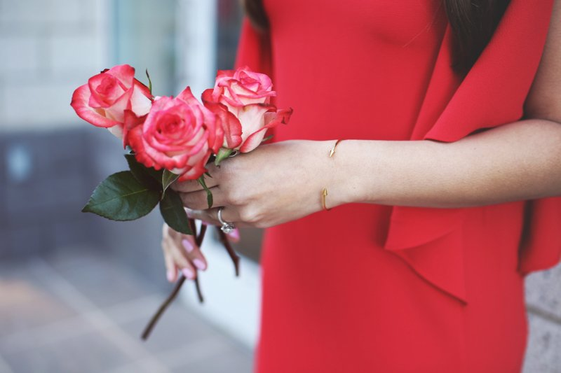 Red cocktail dress and gold accessories. This red cocktail dress is under $100! Perfect for Valentine's Day or date night outfit idea. Click to see the rest of the outfit.