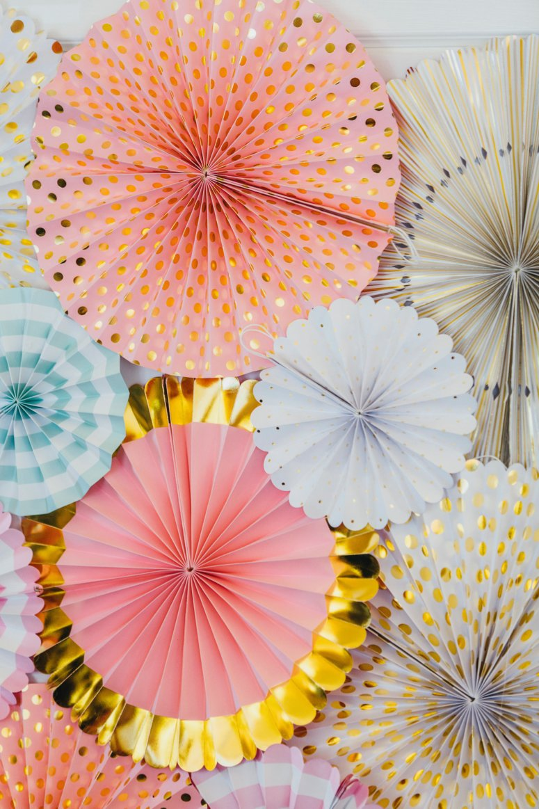 Pink and gold paper fans for baby shower, bridal shower. Click to see the rest of the baby shower decor in the post!
