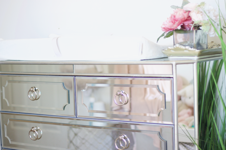 mirrored dresser as changing table for nursery