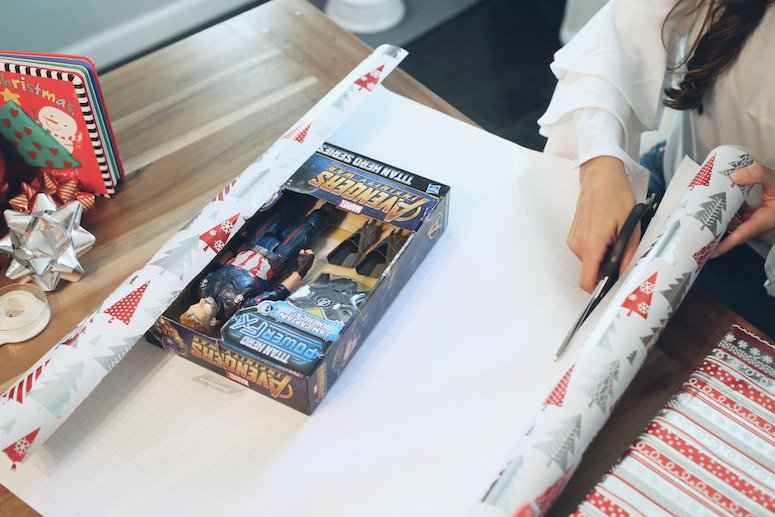Avengers action figure doll being wrapped for christmas gift for toddler | lifewithmar.com