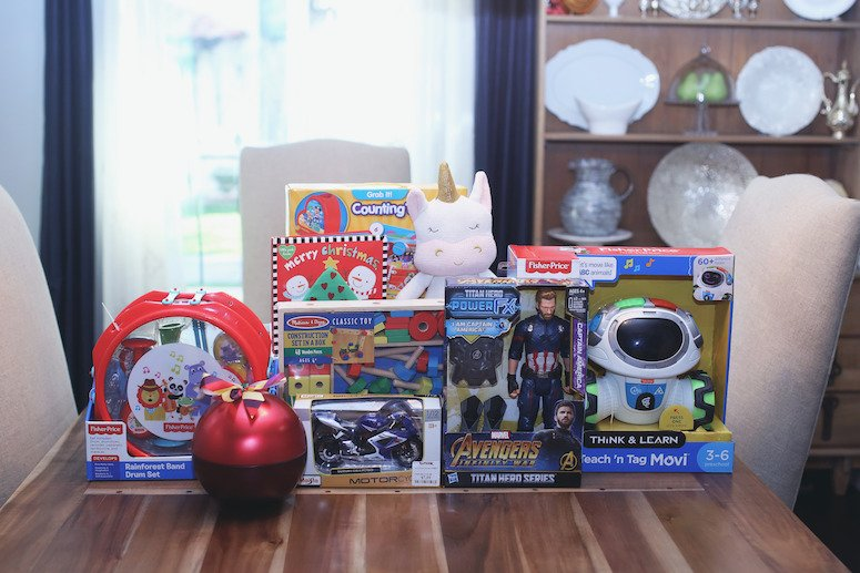 The Ultimate Toddler Christmas Gift List at TJ Maxx! | Stack of kids presents on a table | Lifewithmar.com