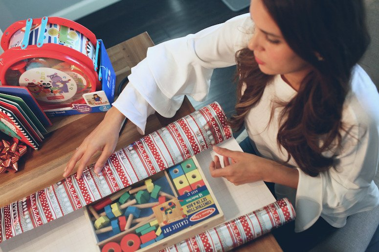 Brunette woman wrapping Melissa and Doug classic playlet | toddler and baby christmas gift ideas | lifewithmar.com