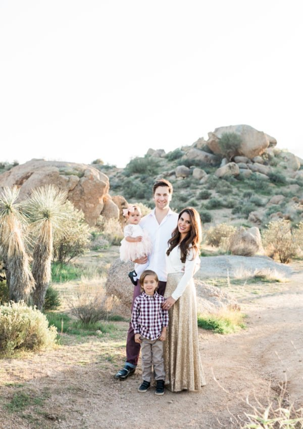 What to wear for family pictures outside | family of 4 standing in Arizona desert for family photos, woman in gold sequin skirt | lifewithmar.com