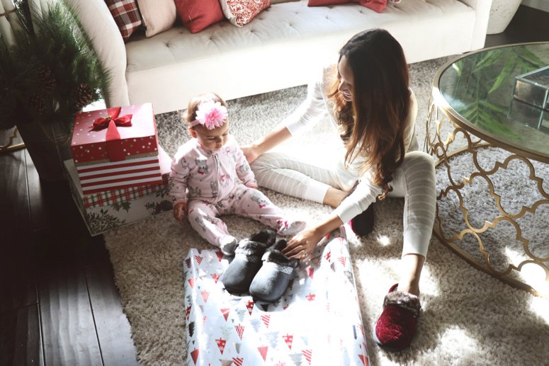 Isotoners review, the best house slippers that are cute and comfy and provide great memory foam support! Perfect gift idea for her. | LifewithMar.com | Mom with baby and presents on floor.