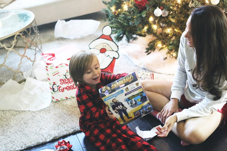 toddler and baby christmas gift ideas | toddler boy opening up avengers christmas present | lifewithmar.com