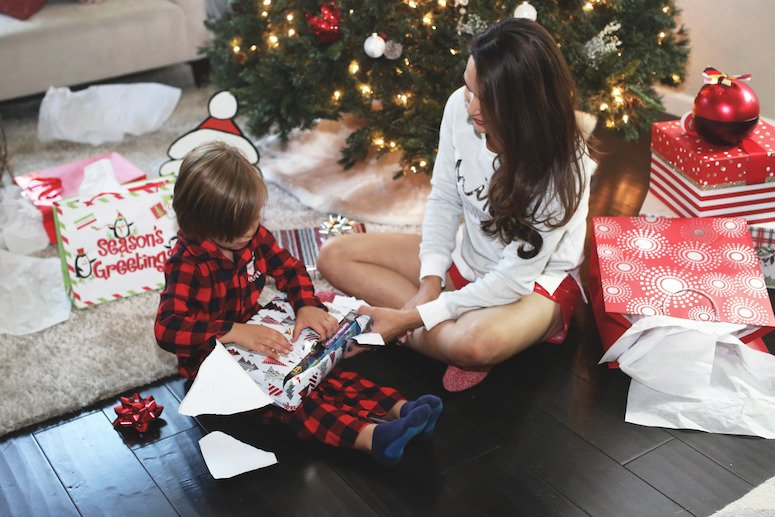 toddler christmas gift ideas toddler and mom under christmas tree opening presents lifewithmar