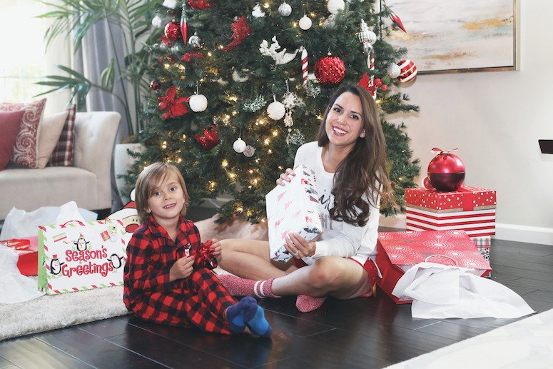 toddler christmas gift list and ideas | mom and toddler sitting under christmas tree together | lifewithmar.com
