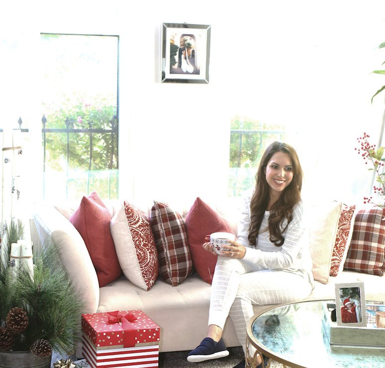 brunette woman sitting on couch with tea
